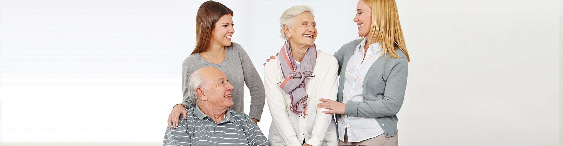 two women and an elderly couple