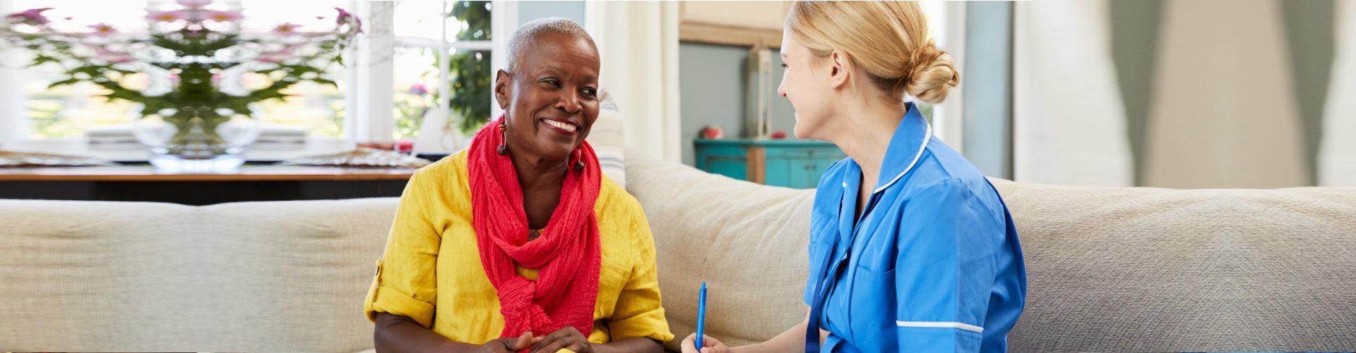 caregiver talking to a senior woman
